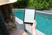 Woman enjoying an ebook by a pool