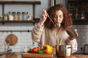 woman making soup