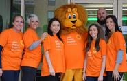 Neopost team with hospice mascot Frankie