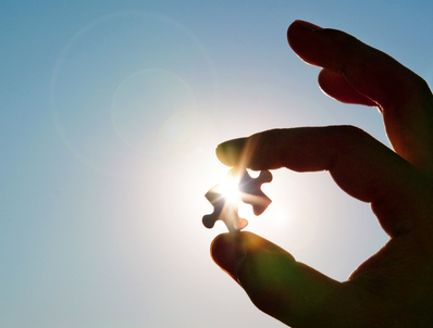 Image of jigsaw piece held against the sun