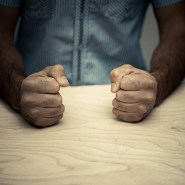 Man clenching his fists