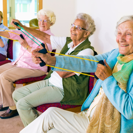 Elderly people exercising in a group