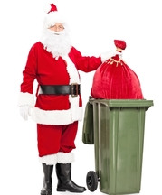 Father Christmas and recycling bin