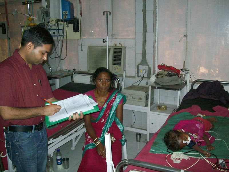 EIS officer Dr. Kapil Goel interviewing the mother of a