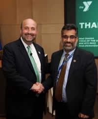 Dr. Khan thanks Neal Denton, from Y-USA, for visiting and presenting at PHPR's Director's Seminar Series.