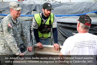 An AmeriCorps team leader serves alongside a National Guard member and a community volunteer in response to flooding in Clarksville, MO.