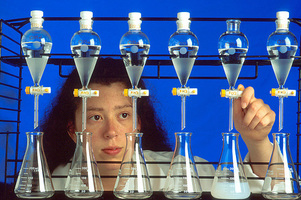 Elizabeth Denvir, Agricultural Research Service biological laboratory technician, extracts samples. USDA photo.