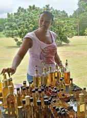 Dara Hamilton sells mead (honey wine) at the July 27, 2013 VI Value-Added Market Day at the VI Ag Fair Grounds.