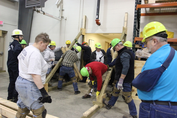 Erie County CERT volunteers assemble a Raker Shore as part of a course on structural collapse rescue operations.