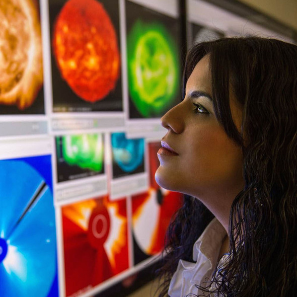 Dr. Yaireska Collado-Vega, a heliophysicist at NASA looks closely at satellite imagery of the sun. As a heliophysicist, Dr. Collado-Vega studies spa