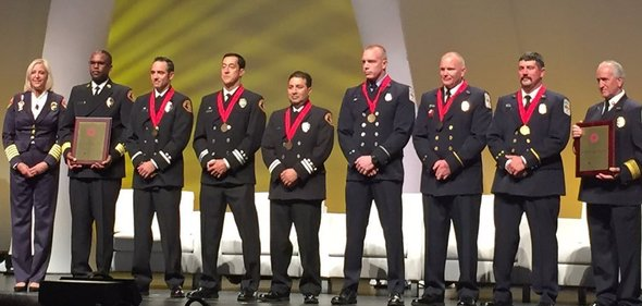 Members of the FEMA urban search and rescue team being awarded in Nepal and receiving medals (Benjamin Franklin Award for Valor).