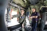 Major Nicole Mitchell and Mark Peterson aboard a Hurricane Hunter.