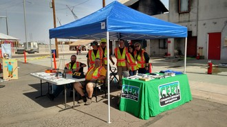 Members of the Tempe CERT stand under a tent at a local event