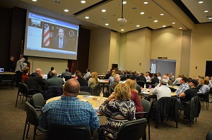 Participants at a Dec. 10 poultry processing workshop in Arkansas watch a video message from OSHA Assistant Secretary Dr. David Michaels.