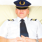 A photo of a commercial pilot sleeping.