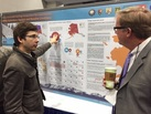 A Volpe employee presents a poster at TRB.