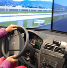 Hands hold the steering wheel of a car simulator at Volpe.