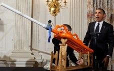 Obama and student with marshmallow shooter