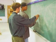 teacher and student at chalkboard