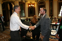Arne Duncan talkig with a STEM teacher at the White House