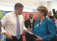Arne Duncan speaking with an educator.