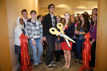 cutting the ribbon at the showing