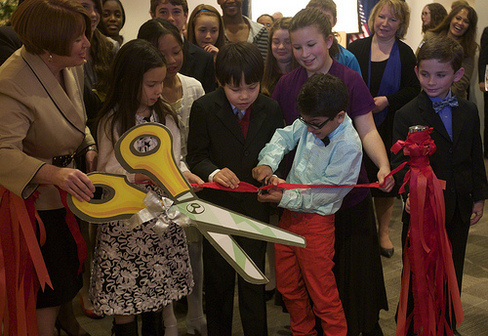 ribbon cutting at student art exhibit