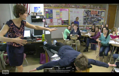 video clip of student facedown on a table