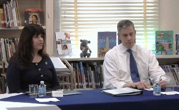 Arne Duncan with a teacher at Rogers Heights