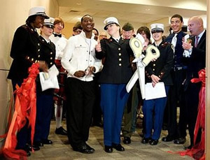 ribbon cutting at premier of military students' art