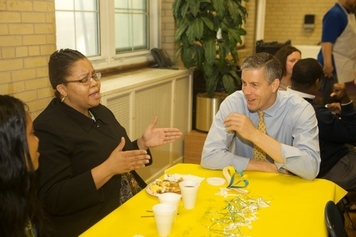 Arne Duncan and teachers at Kramer Middle School