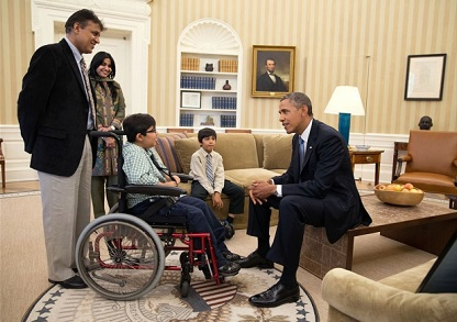 President Barack Obama visits with Make-A-Wish child Suhail Zaveri, 14, from Anaheim, Calif., in the Oval Office, July 16, 2013.