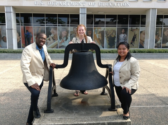 FEA officers standing next to education bell