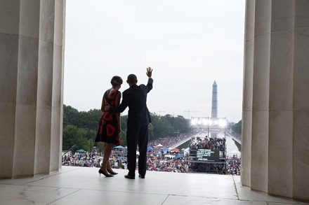 President Barack Obama and First Lady Michelle Obama wave to the crowd at the end of the Let Freedom Ring ceremony to commemorate the 50th anniversary