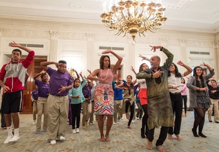 First Lady Michelle Obama joins students for a Bollywood Dance Clinic in the State Dining Room of the White House, Nov. 5, 2013. (Official White House