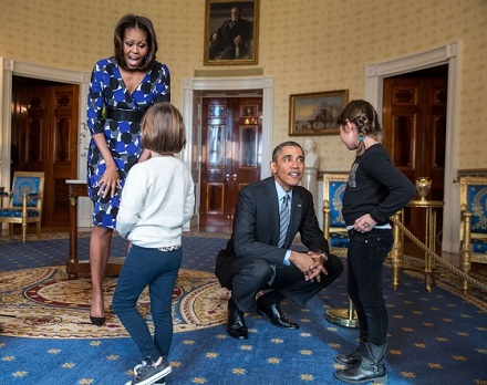 President Barack Obama and First Lady Michelle Obama greet visitors in the Blue Room during a White House tour. (Official White House Photo by Pete So