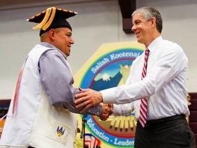 Arne Duncan congratulates a graduate from Salish Kootenai College