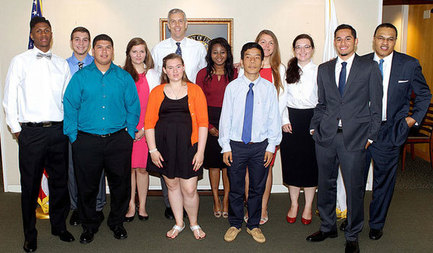 Secretary Duncan takes a photo following his meeting with a group of young people.