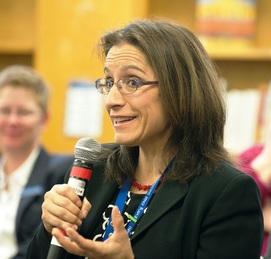 teacher speaking during leadership roundtable