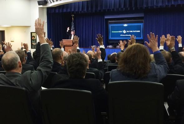 hands raised - superintendents