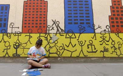 girl working in front of mural