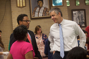 Secretary Duncan talking with educators
