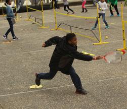 kid hitting tennis ball