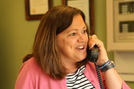 Teacher receiving a phone call from Arne Duncan