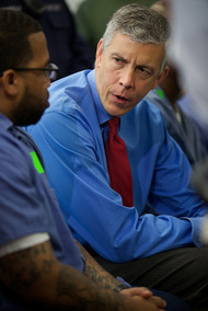 Secretary Duncan with an inmate during the announcement of his initiative