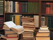 books piled up image