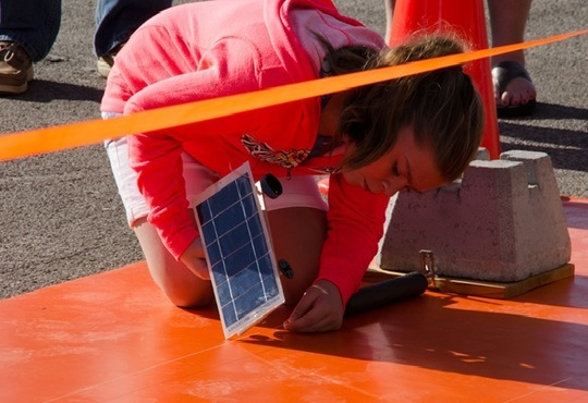 Student setting up for solar car race in Alachua County Schools FL