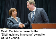 """David Danielson presents the """"Distinguished Innovator"""" award to Dr. Min Zhang"""