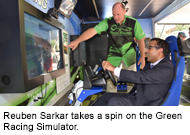 Reuben Sarkar rides the Green Racing Simulator at Sustainable Transportation Day