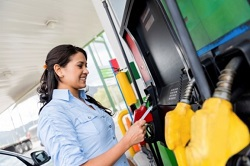 Woman at gas pump